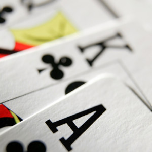 Hand of cards showing an ace, king & queen