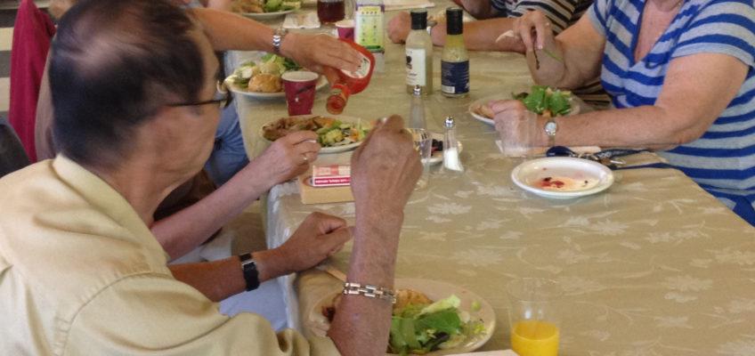 Seniors eating dinner